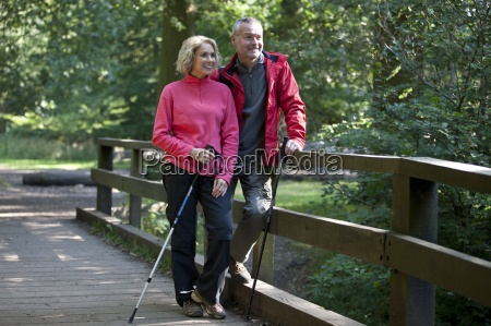 a mature couple standing on a