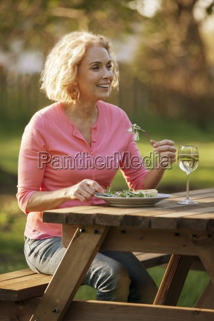 a mature woman sitting at a