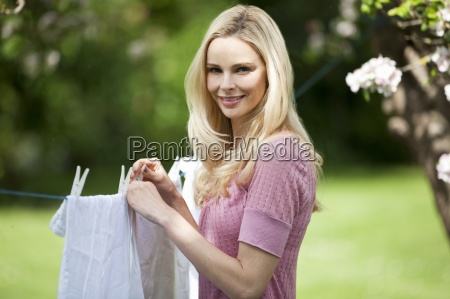 a young woman hanging out washing