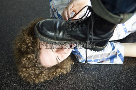 young man lying on ground about