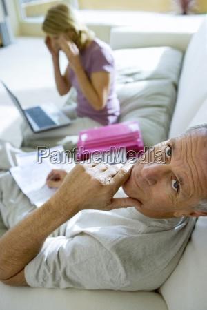 mature woman sitting on sofa at