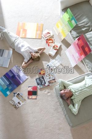 senior couple lying on floor and