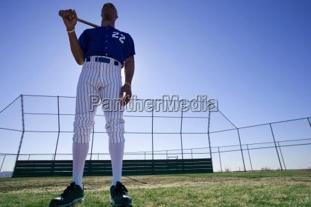 baseball batter wearing number xe2x20acx2dc22xe2x20acx2122 blue