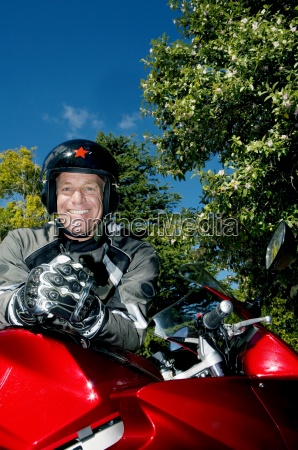 senior man wearing crash helmet and