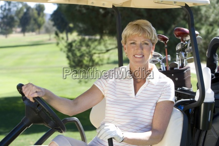 mature woman in striped polo shirt