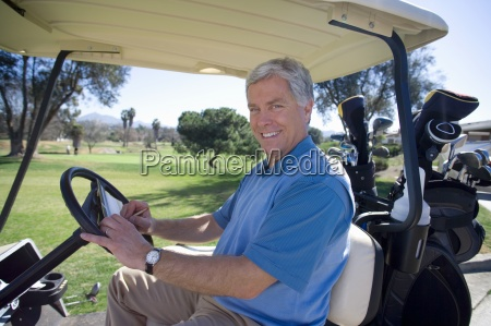mature man in blue tank top
