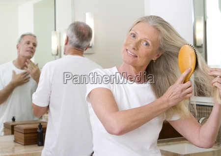 senior couple getting ready in bathroom