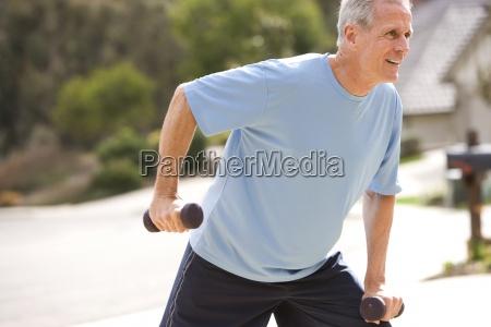 active senior man in blue t