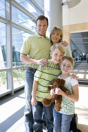 family standing in airport girl 7