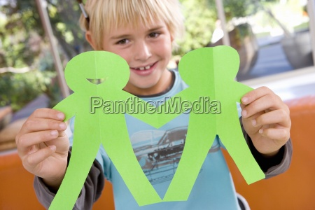boy 6 8 holding paper cut