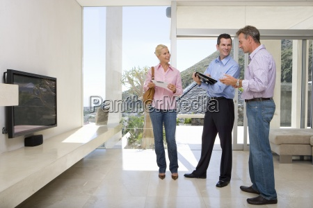 male real estate agent standing with
