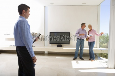 male real estate agent looking at
