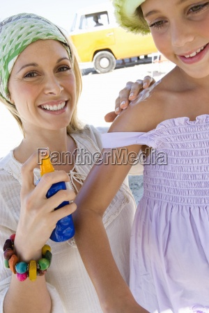 mother applying sunscreen to daughter 5