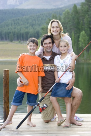 family of four with fishing rod