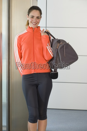 woman in fitness clothes with bag