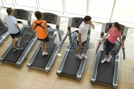 people on treadmills in gym man