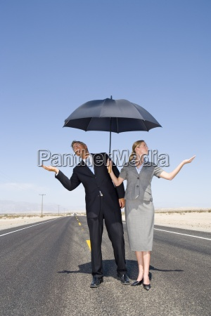 businessman and woman on open road