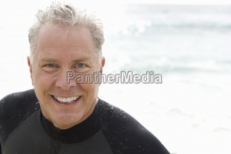 man in wetsuit smiling portrait