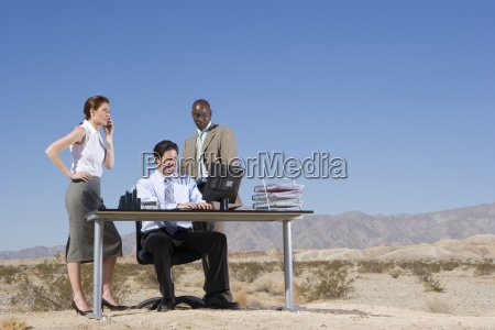businessman and woman by colleague using
