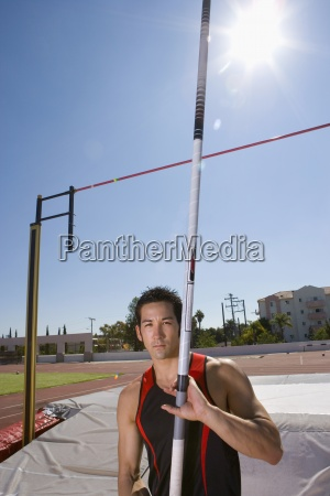young male pole vault athlete with
