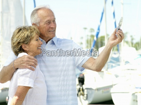 senior couple arm in arm by