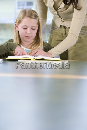 mother helping daughter 7 9 with