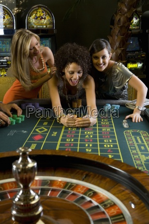young woman collecting pile of gambling