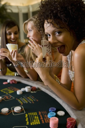 young woman gambling at poker table