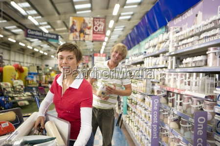 couple in hardware store smiling portrait