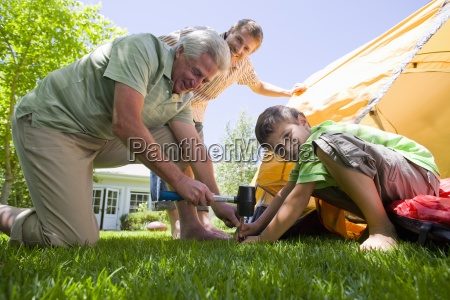 fathers and sons setting up tent