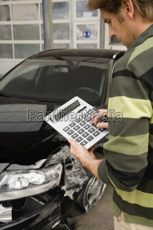 insurance adjuster assessing damage to car