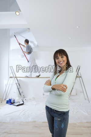 woman smiling as man on wood