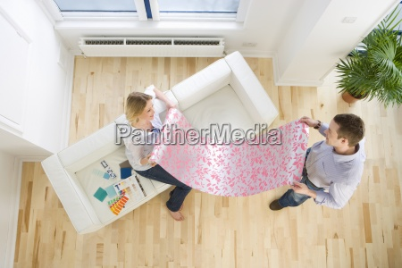 couple looking at wallpaper sample in