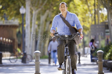spain barcelona man cycling in city