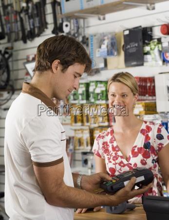 man using credit card reader in