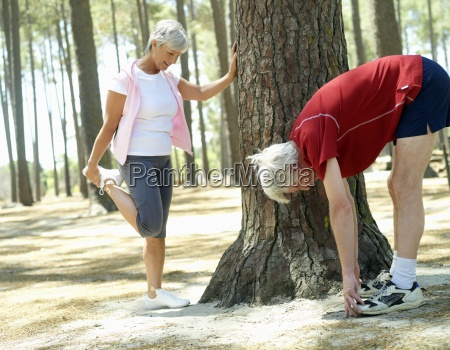 active senior couple in sportswear stretching