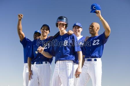 baseball team in blue uniforms celebrating