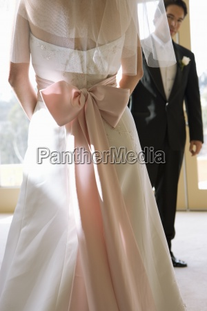 bride wearing wedding dress with pink