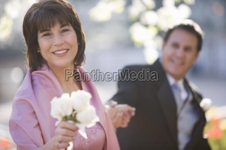 senior couple posing at wedding focus