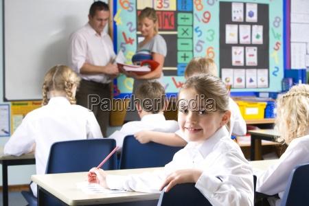 teachers and school children in classroom