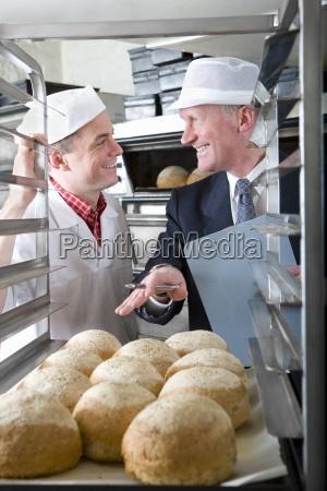 inspector talking with baker in bakery
