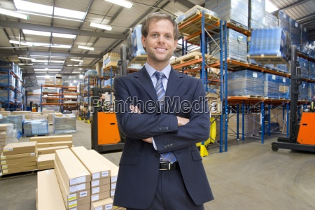 portrait of smiling businessman with arms