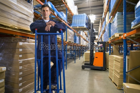 portrait of warehouse worker leaning on