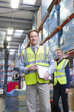 portrait, of, smiling, warehouse, manager, and - 12939862