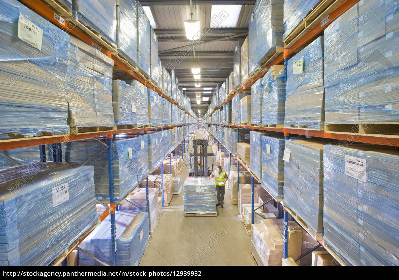 warehouse, worker, inspecting, boxes, on, forklift - 12939932