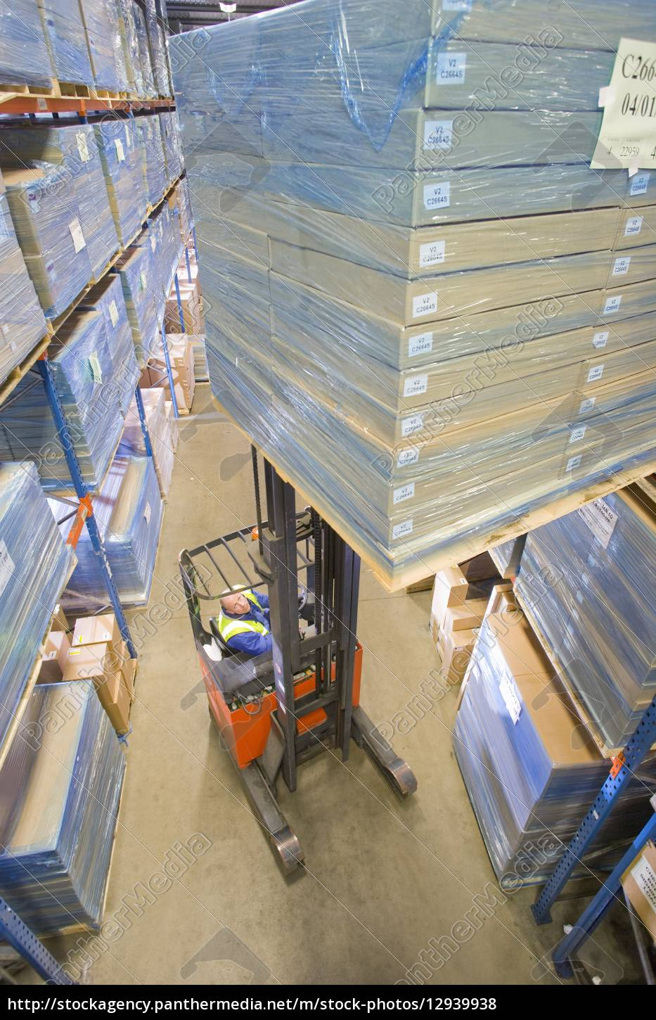 warehouse, worker, moving, boxes, on, forklift - 12939938