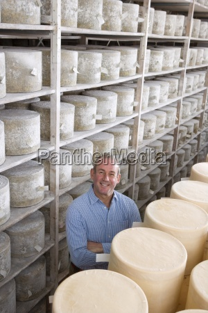 portrait of smiling cheese maker in