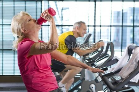 senior woman drinking from water bottle