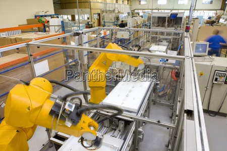 robotic arms working on factory assembly