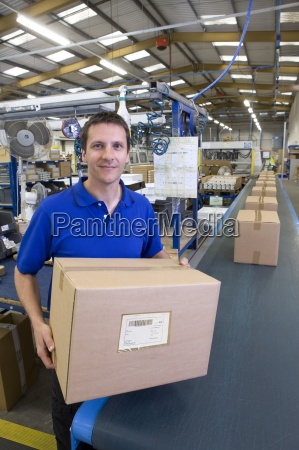 worker in warehouse on assembly line